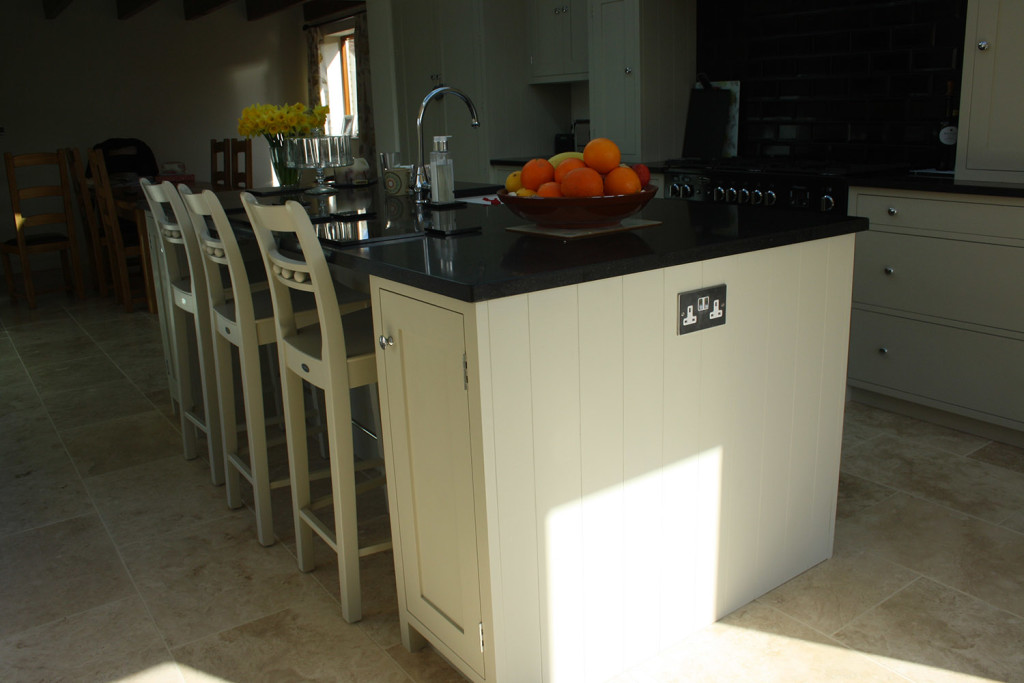 handmade bespoke painted island unit with chairs