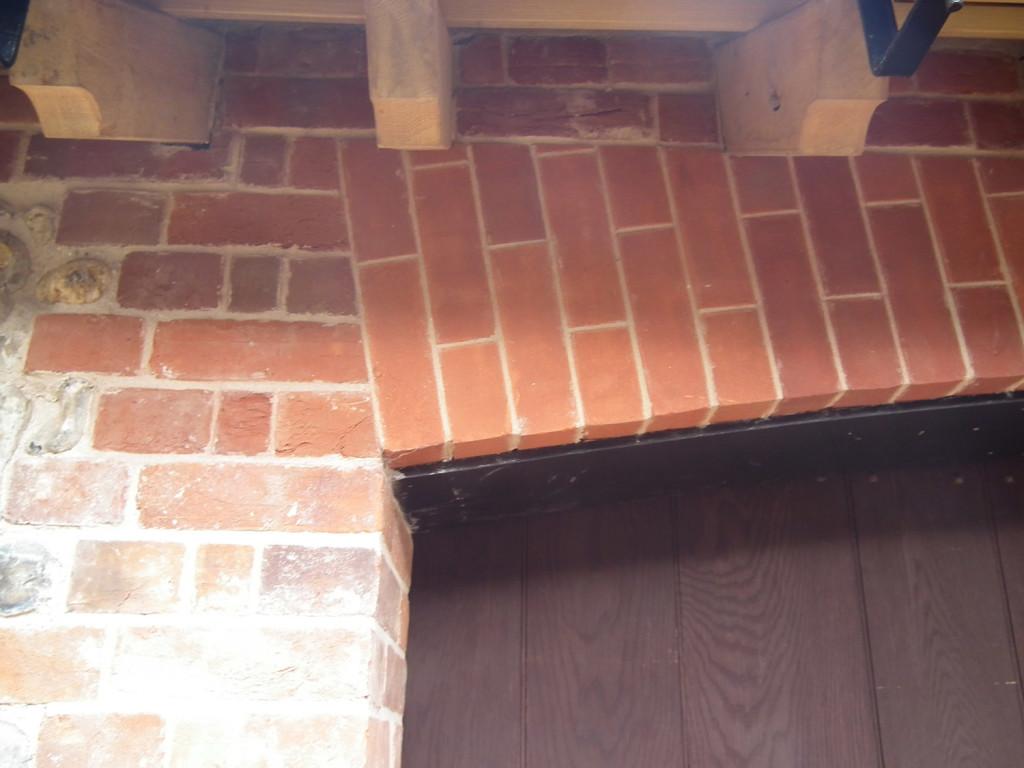 oak gate and brickwork